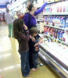 Mother and children in a grocery store