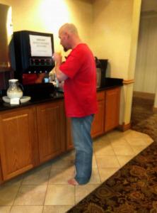 Man-in-hotel-self-serve-breakfast-areagraded