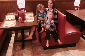 Woman-sitting-with-children-in-a-restaurantsharpbright