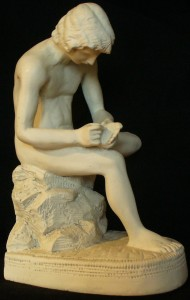 Replica of Boy with Thorn, an ancient Greco-Roman Hellenistic bronze sculpture, currently in the Palazzo dei Conservatori, Rome